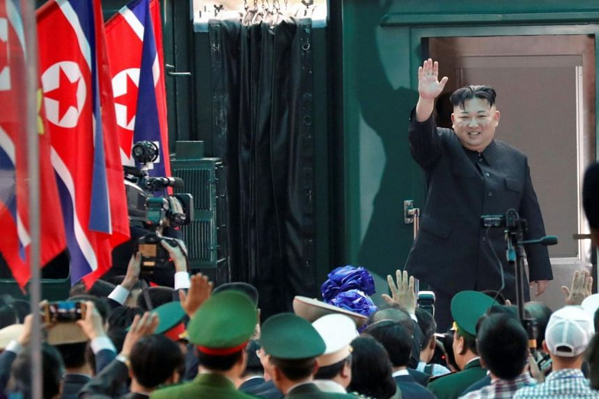 North Korean leader Kim Jong Un bids farewell before boarding his train to depart for North Korea at Dong Dang railway station in Vietnam on March 2, 2019.
