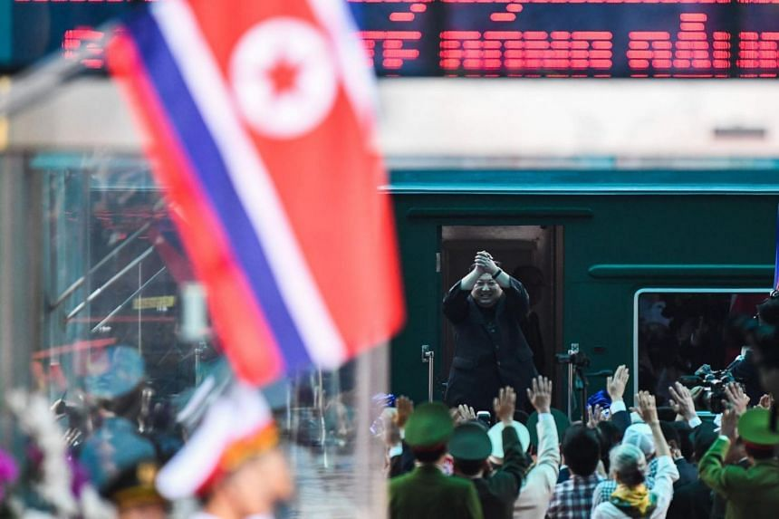 North Korea's leader Kim Jong Un waves before boarding his train at the Dong Dang railway station in Lang Son on March 2, 2019.