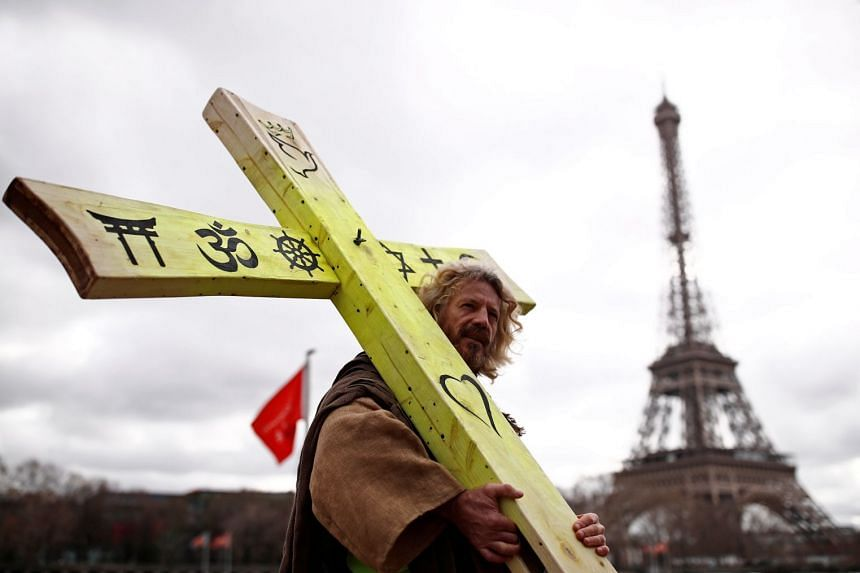 A yellow vest protester walks past the Eiffel tower during a demonstration in Paris, March 2, 2019.