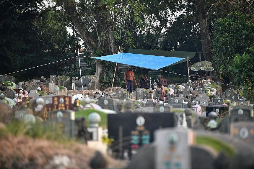 One of the makeshift homes in Choa Chu Kang Cemetery. The worker in the foreground, who has been in Singapore for six months, claims to have been promised a job here but ended up being cheated of about $2,000. Myanmar nationals squatting at the cemet