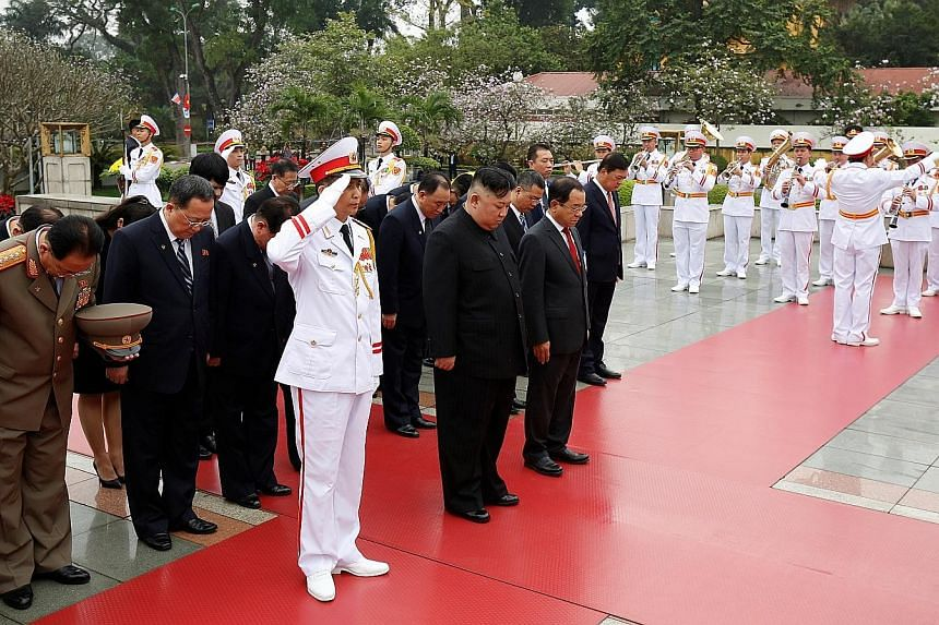 Mr Kim Jong Un attending a wreath-laying ceremony at the Monument to War Heroes and Martyrs in Hanoi yesterday. His trip to Vietnam was the first by a North Korean leader since 1964.