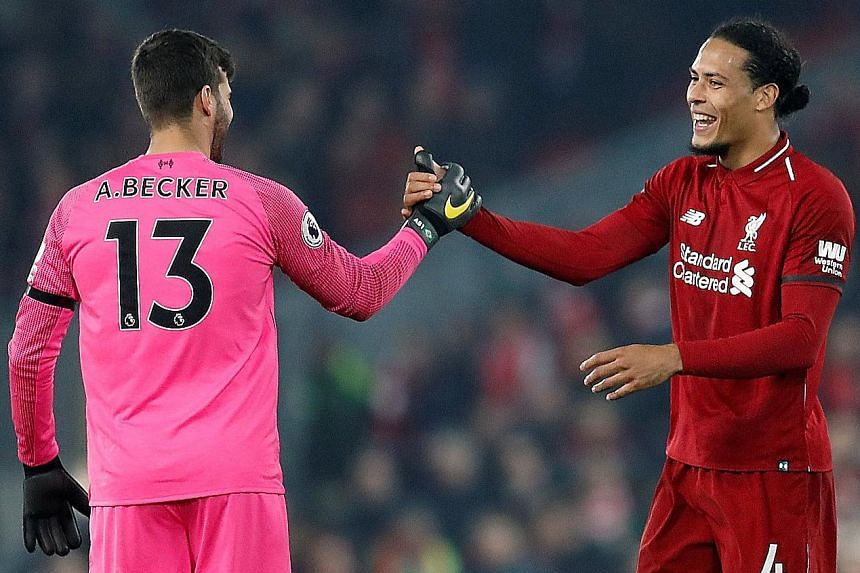 "Liverpool defender Virgil van Dijk, with goalkeeper Alisson Becker, is expecting ""a game full of passion"" against Everton today at Goodison Park, which will host its 100th league meeting between the clubs."