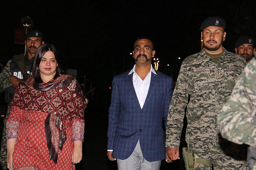 Indian pilot Abhinandan Varthaman (centre) being escorted across the border into India on Friday, after being released by the Pakistani authorities. Media reports said his return had been held up as he was forced to make a video.