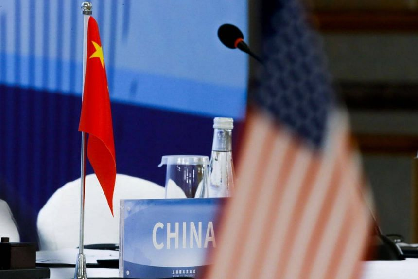 The Chinese and US national flags seen before the start of a conference in Beijing, on Jan 30, 2019.