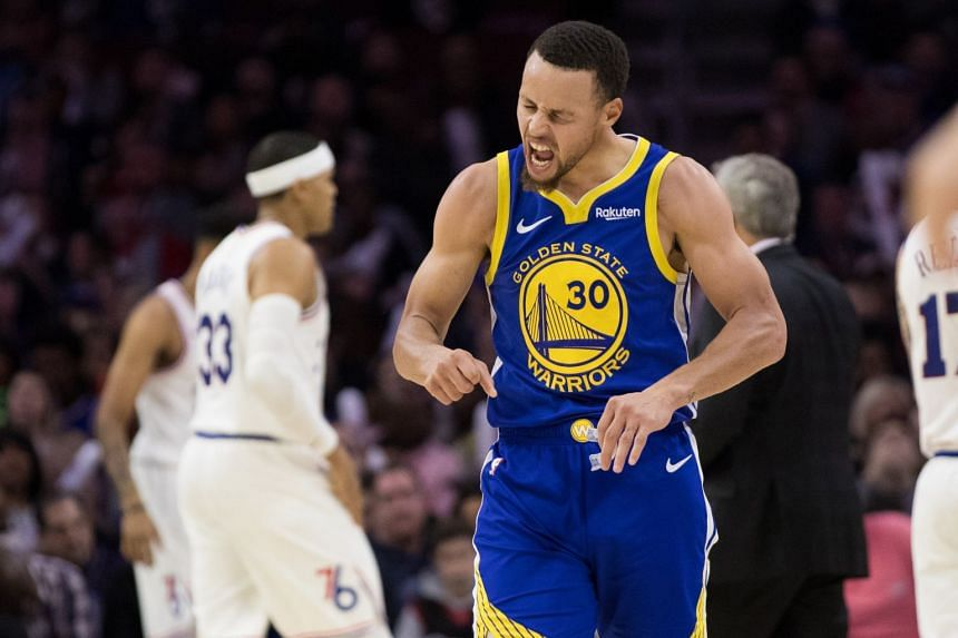 Golden State Warriors guard Stephen Curry celebrating after making a three-pointer against the Philadelphia 76ers, on March 2, 2019.