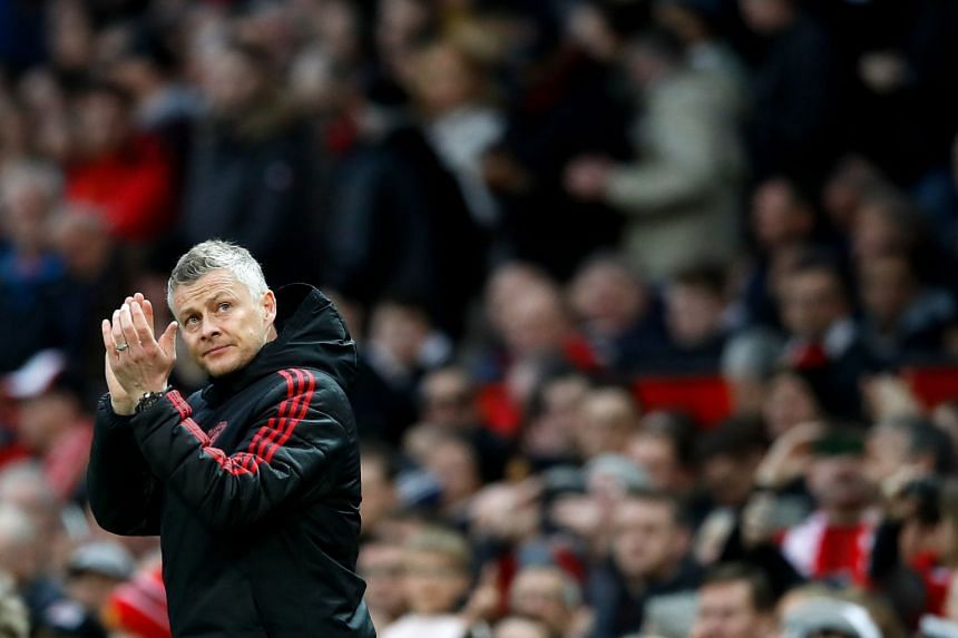 Solskjaer applauds during United's match against Southampton at Old Trafford.