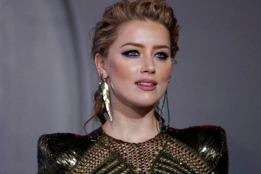 Amber Heard (pictured), the former wife of Johnny Depp, had accused him of domestic violence, and had written an article on the topic for the Washington Post in December.