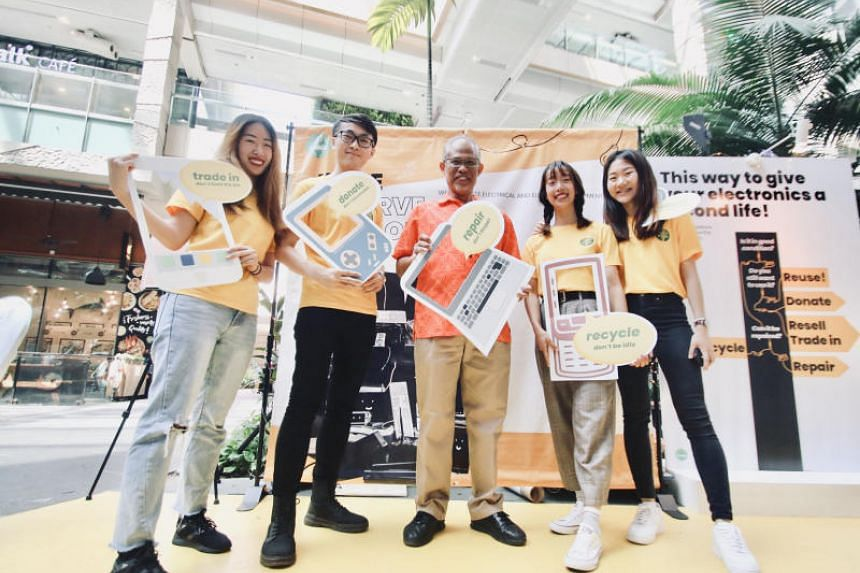 Minister for the Environment and Water Resources Masagos Zulkifli joined four students from four tertiary institutions to pledge to reduce and recycle e-waste on their campuses, at Westgate Mall on March 3, 2019.