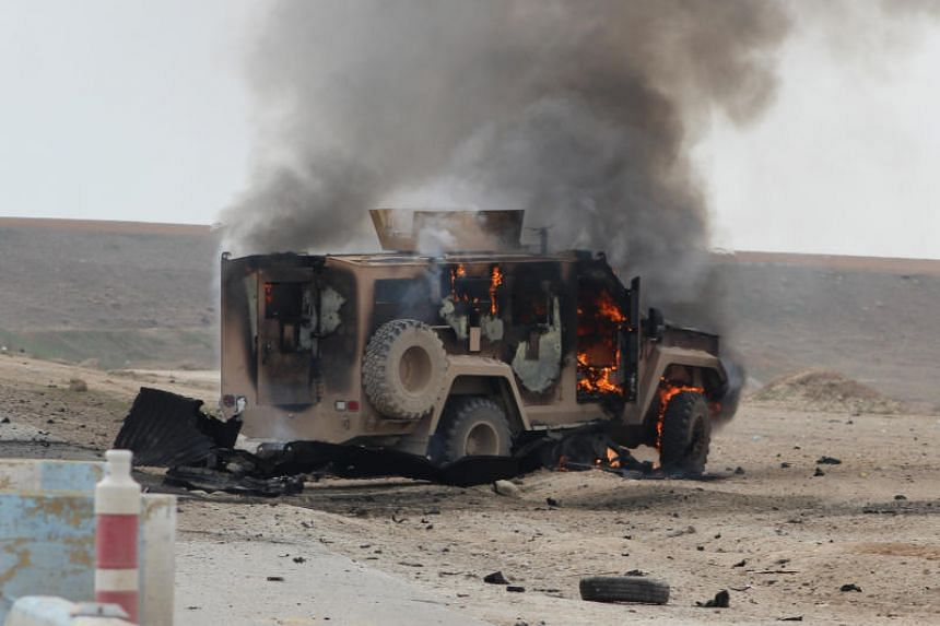 A vehicle burning at the site of a suicide car bomb attack in Syria's Hasakeh province on Jan 21, 2019. The Syria Democratic Forces said ISIS launched suicide attacks to stave off defeat, on March 3, 2019.