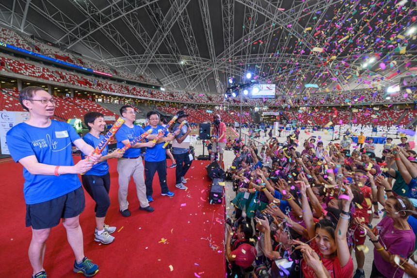 Minister for Culture, Community & Youth Grace Fu (second from left) cheering with other participants at the Singapore Cancer Society's TalkMed Relay For Life, which raised over $1 million.