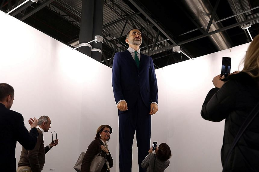 The buyer of the statue of Spain's King Felipe VI must burn the artwork within a year and film it as a performance.