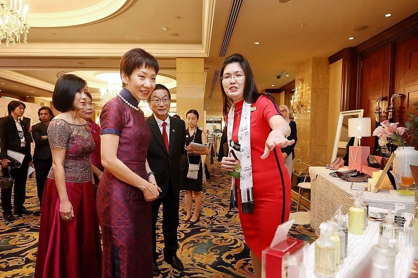 Minister for Culture, Community and Youth Grace Fu speaking to Ms Lynn Yap (right), founder of personal care products brand Clynn by Nature, at her booth at Marketplace by Crib yesterday. Crib is a non-profit group that helps build business networks