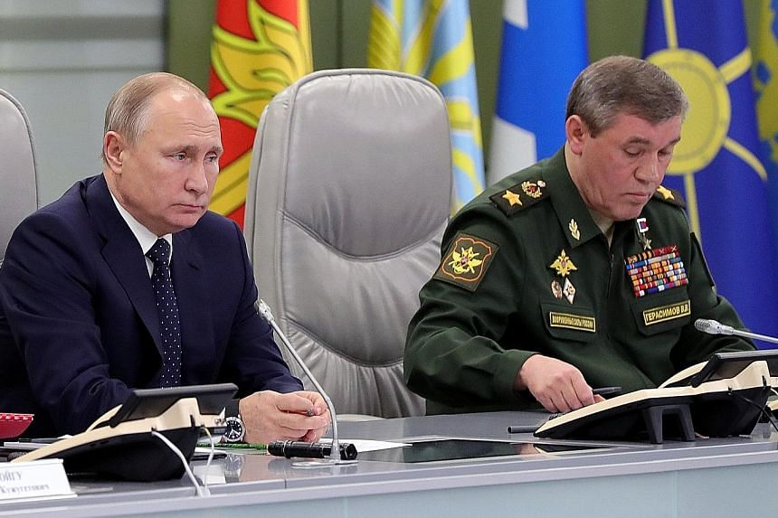 Russian President Vladimir Putin with the country's Chief of the General Staff, General Valery Gerasimov, during a meeting last December.