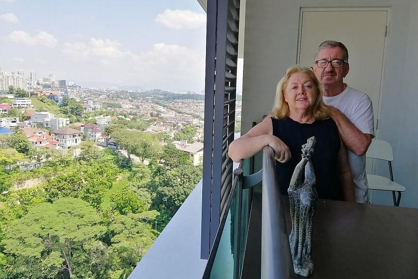 Mr Martin Walsh and his wife, Darina (above), in their Bangsar condo unit in Kuala Lumpur. The Irish couple have 10-year visas under the Malaysia My Second Home programme.Austrian citizen Markus Hoffman (left) lives in Penang under the same visa prog