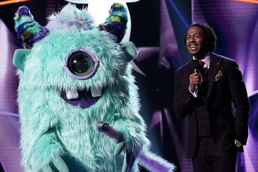In the finale of The Masked Singer - the American version of the reality TV programme hosted by Nick Cannon (right) - the one-eyed Monster (left) turned out to be rapper T-Pain. Stars appearing in the show included singers Gladys Knight and Donny Osmond,