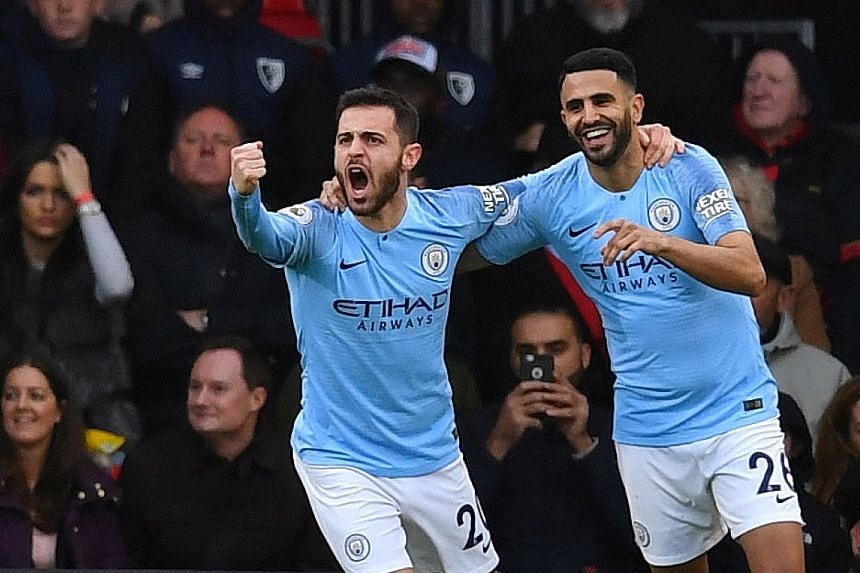 Riyad Mahrez (right) celebrating with Bernardo Silva after scoring against Bournemouth at the Vitality Stadium. Although it was the only goal of the match, champions City were overwhelmingly dominant with 82 per cent of possession.