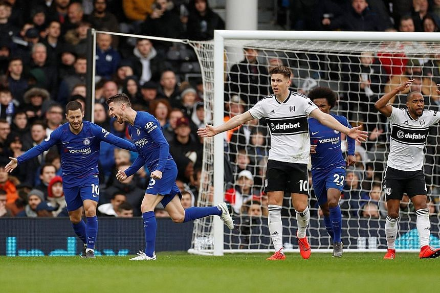Jorginho (second from left) in pure joy as he celebrates his goal with teammate Eden Hazard, the creator of his strike from outside the penalty box, while Fulham's Tom Cairney lifts his hands to question his side's defending. The Chelsea midfielder s