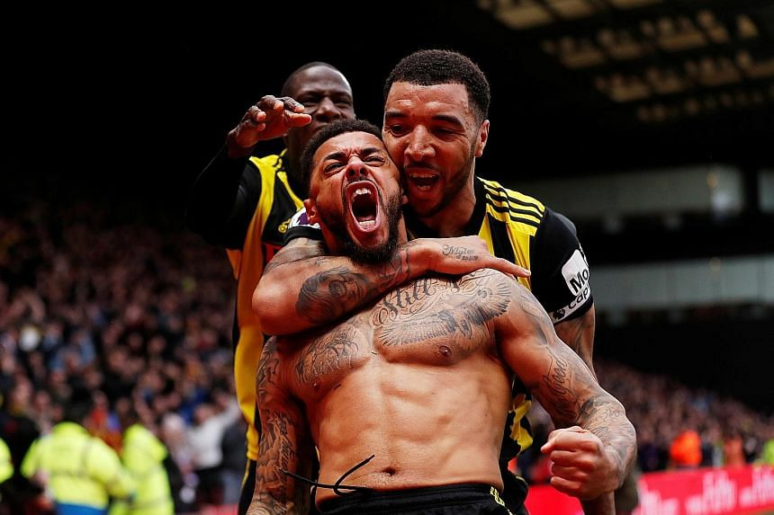 Watford substitute Andre Gray celebrates scoring his team's winner in added time to spoil Leicester manager Brendan Rodgers' first game in charge.