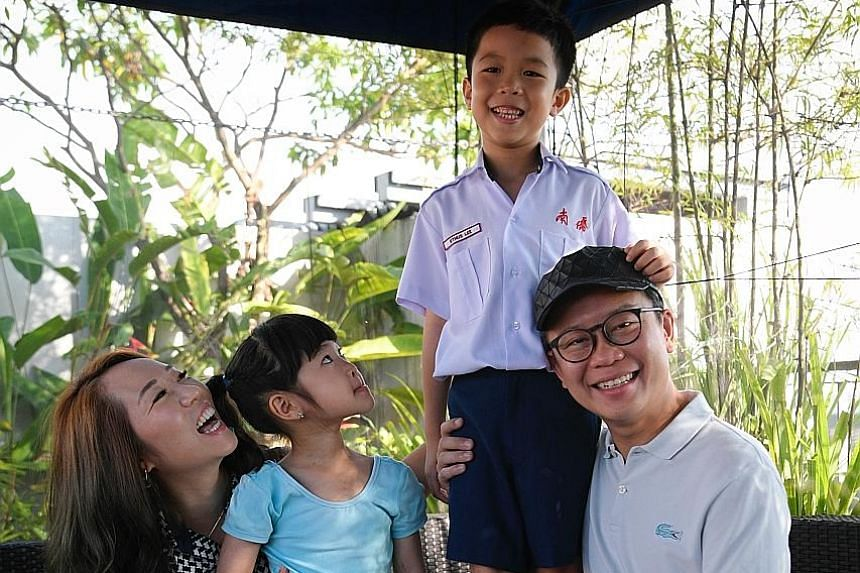 Mr Lee Vern Long and his wife Sandra Kang, 35, with their son Ethus, seven, and daughter Love, five. Mr Lee joined the clan association three years ago, after enrolling his daughter in its weekly dance classes.