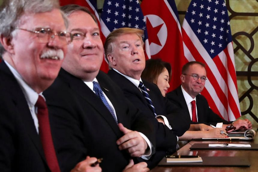 White House national security adviser John Bolton (left) and others attend the extended bilateral meeting in the Metropole hotel with North Korea's leader Kim Jong Un and his delegation during the second North Korea-US summit in Hanoi, Vietnam, on Fe