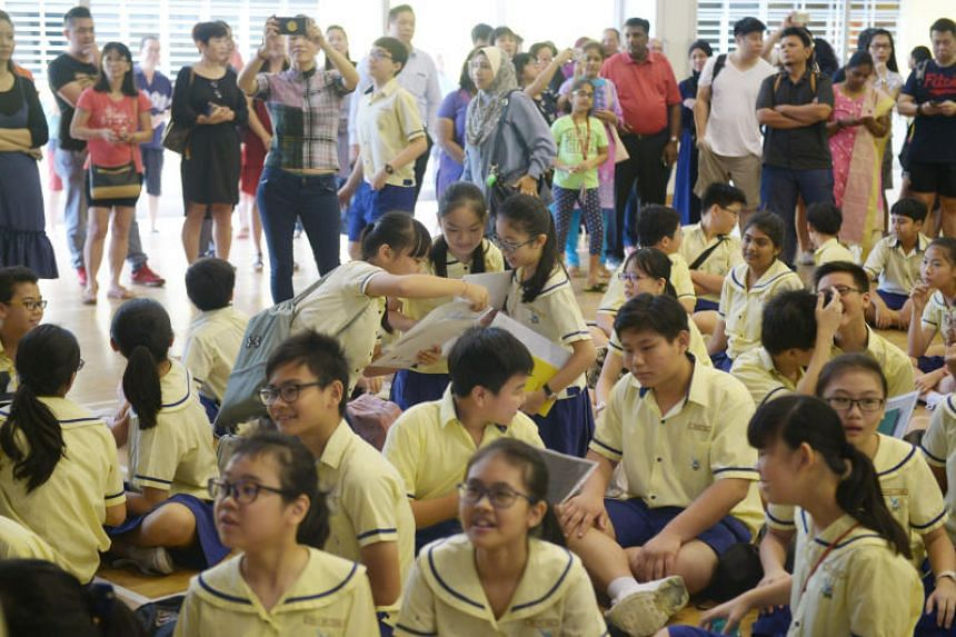 Lakeside Primary School pupils collecting their PSLE results on Nov 24, 2017. Several MPs said it's time to move away from streaming children into Normal and Express tracks.