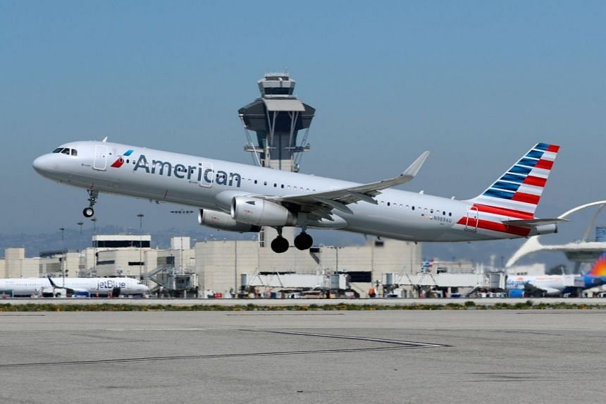 An American Airlines Airbus A321-200 plane taking off from Los Angeles International airport in California, on March 28, 2018.