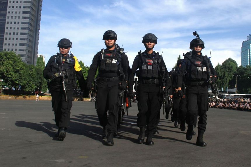 Indonesian police officers gathering for a deployment ceremony in Jakarta, on Dec 21, 2018.