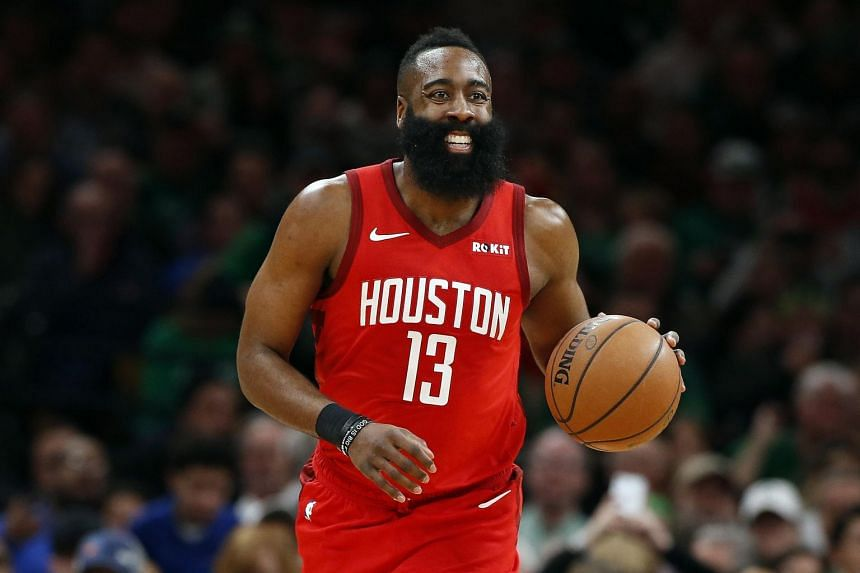 Houston Rockets guard James Harden smiles as he brings the ball up court against the Boston Celtics during the first quarter at TD Garden, on March 3, 2019.