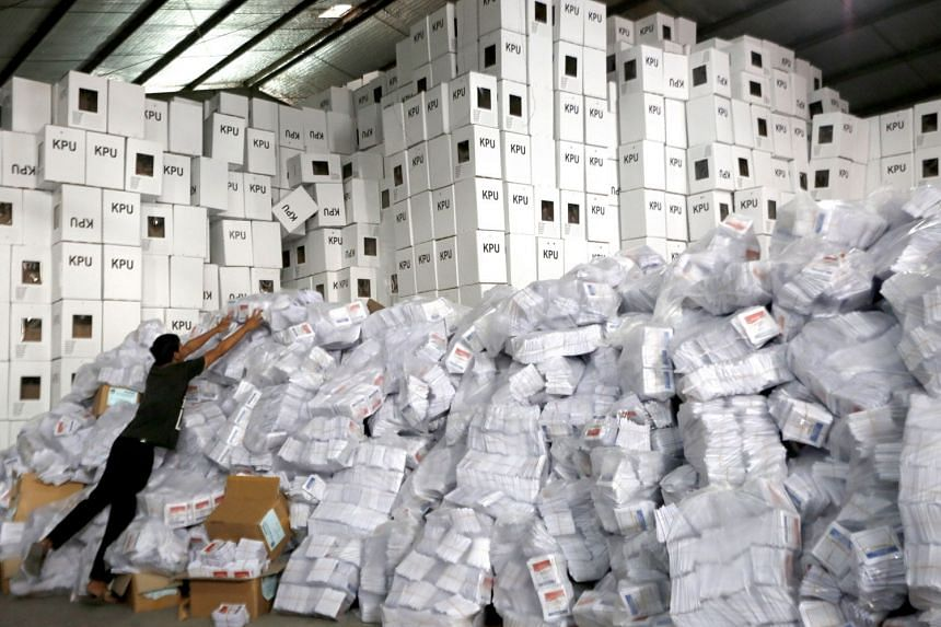 An electoral commission worker sorting ballot papers for the upcoming general elections at a ballot warehouse in Bogor, Indonesia, on Feb 27, 2019.