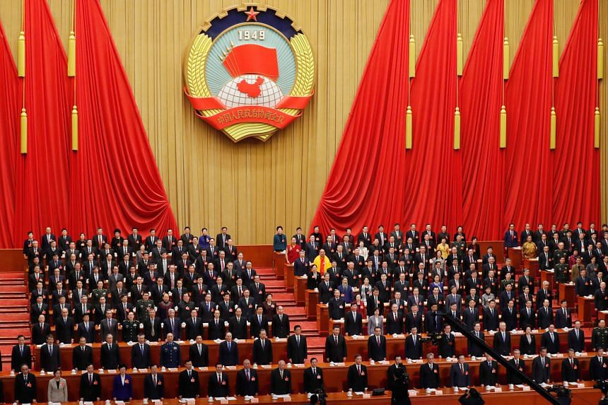 """Delegates attending a session of the Chinese People's Political Consultative Conference at the Great Hall of the People in Beijing yesterday. The CPPCC head said members must keep to the """"correct political direction"""" as China works towards its"""
