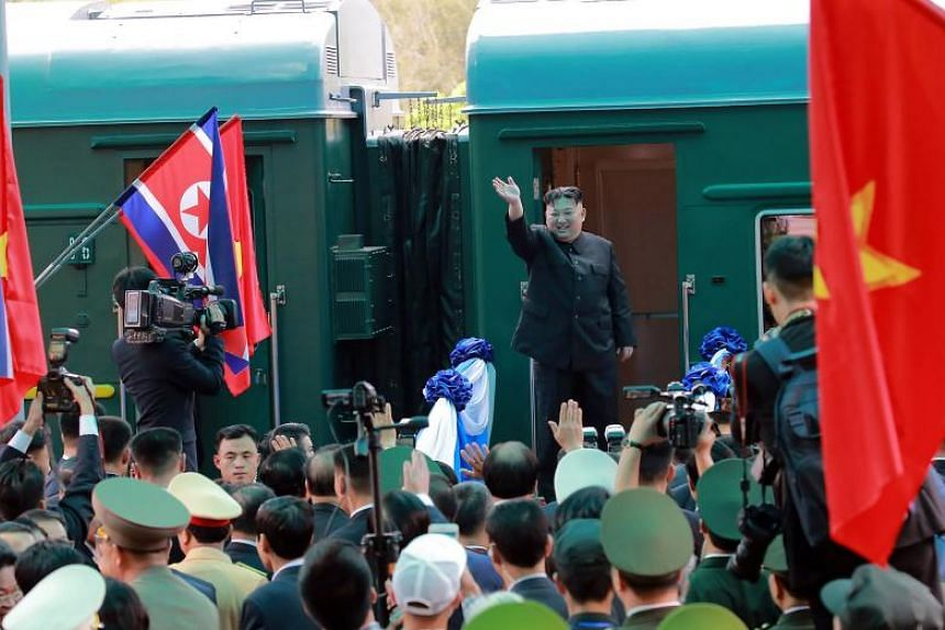 In this picture taken on March 2, 2019 and released from North Korea's official Korean Central News Agency (KCNA) on March 3, 2019 North Korea's leader Kim Jong Un waves before boarding his train at the Dong Dang railway station in Lang Son.