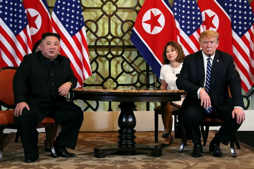 North Korean leader Kim Jong Un and US President Donald Trump listen to questions from the media during the one-on-one bilateral meeting at the second North Korea-US summit in the Metropole hotel in Hanoi.