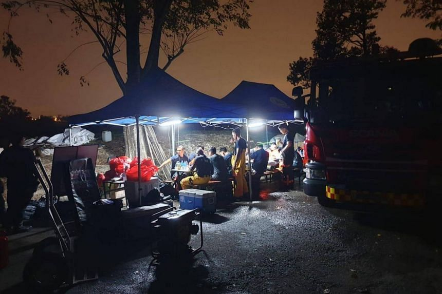 SCDF firefighters recuperating at an on-site rest area.