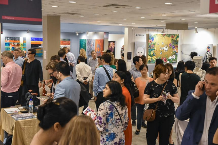 The crowd at Affordable Art Fair Singapore. By making sure there was a wide range of pieces under $10,000, the fair showed art-buying newbies that art didn't have to cost six-figure sums.