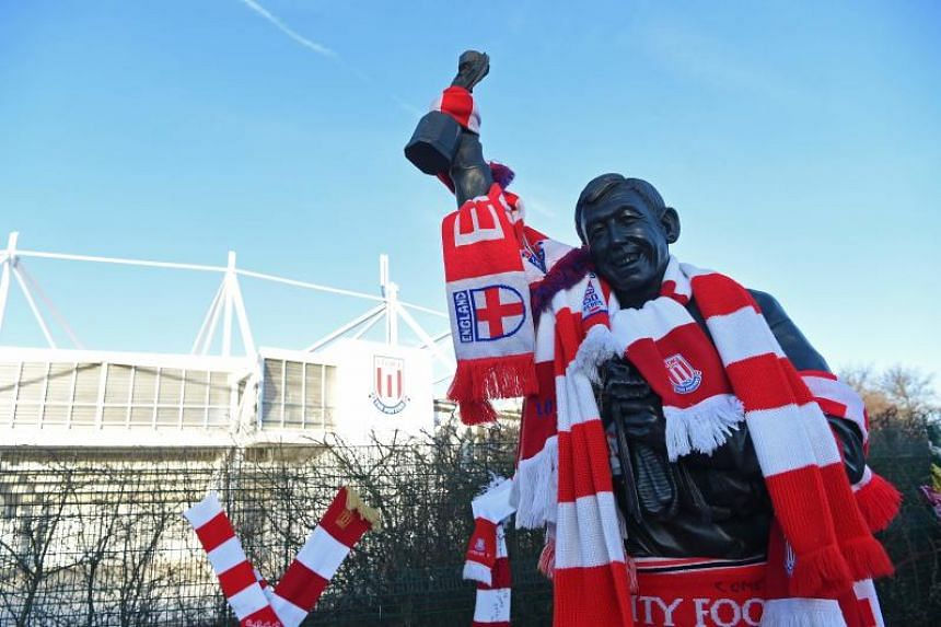 A statue of Stoke City and England's former goalkeeper Gordon Banks is pictured draped in scarves to honour England's World Cup winning goalkeeper.