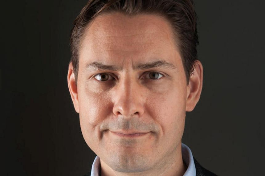"""China said Michael Kovrig had often entered the country using an ordinary passport and business visas, """"stealing and spying on sensitive Chinese information and intelligence via a contact in China""""."""