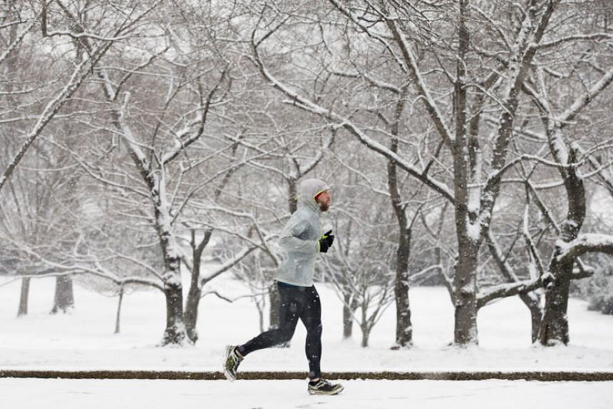 A band of winter weather stretching from Maryland to Maine dumped 38cm of snow overnight on downtown Boston and 13cm on New York's Central Park, said meteorologist Marc Chenard of the National Weather Service.