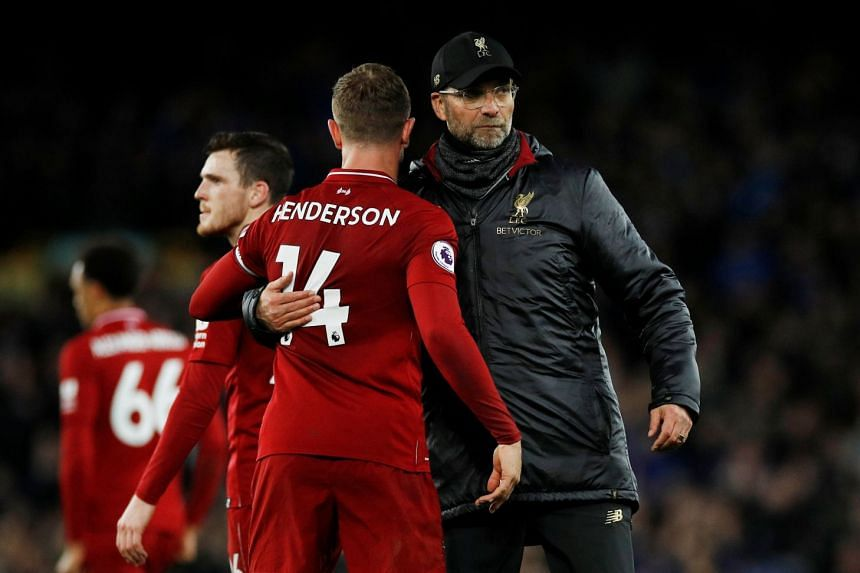 Klopp and Liverpool's Jordan Henderson after their match against Everton.