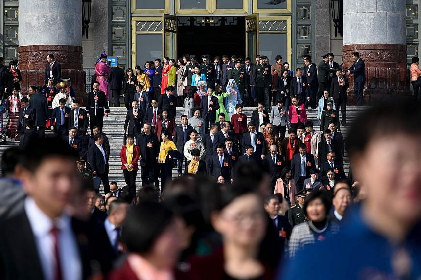 Delegates leaving the Great Hall of the People yesterday after a preparatory meeting ahead of today's opening session of the National People's Congress in Beijing. It will kick off with Premier Li Keqiang delivering the annual Budget. Market and poli