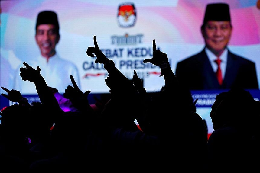Supporters of presidential candidate Prabowo Subianto gesturing as they shout slogans during the second debate with incumbent President Joko Widodo. The Indonesian police say there has been an increase in hostility between supporters of the two camps