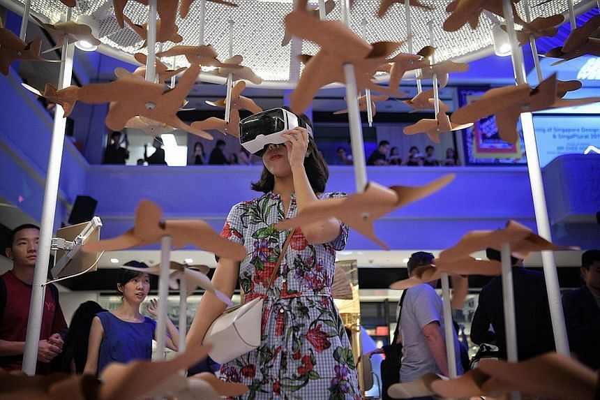 A visitor at an interactive installation at SingaPlural, a design exhibition that is part of Singapore Design Week 2019.