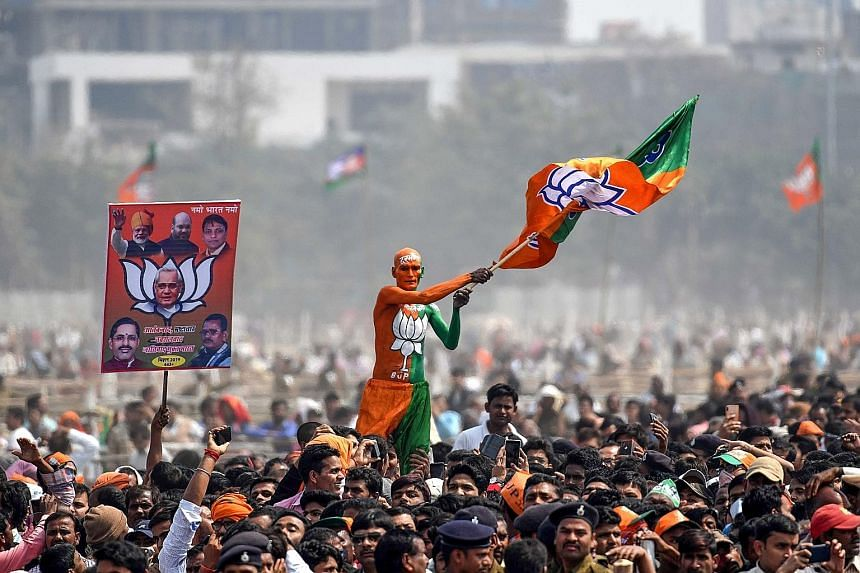 A Bharatiya Janata Party supporter waving a flag at a rally in Patna in the Indian eastern state of Bihar where Prime Minister Narendra Modi spoke on Sunday.
