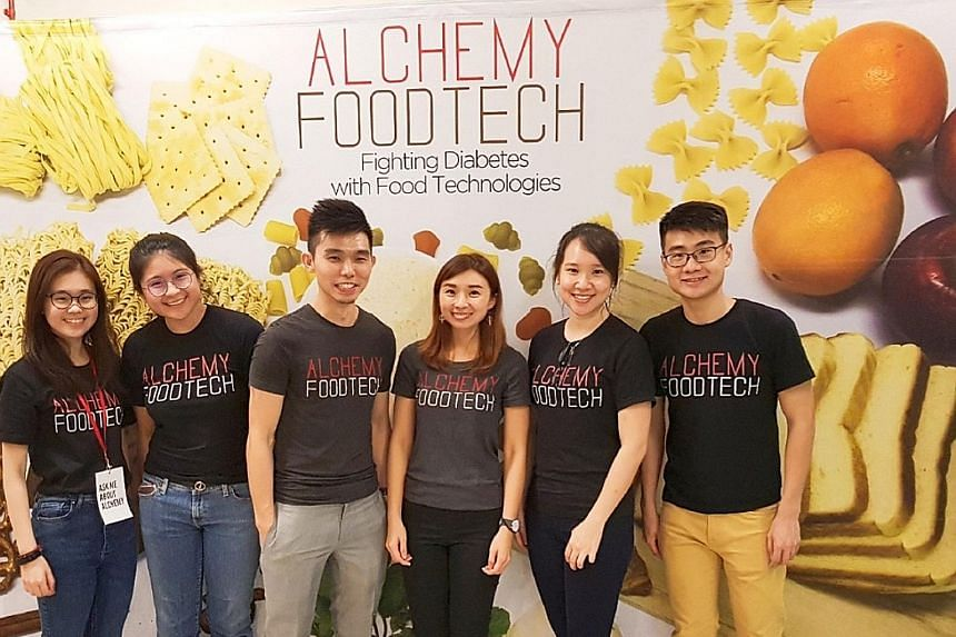 Mr Alan Phua (third from left) and Ms Verleen Goh (fourth from left), co-founders of local start-up Alchemy Foodtech, with their team. Mr Phua said an Enterprise Singapore grant helped his firm take its food technology to market when there was no cer