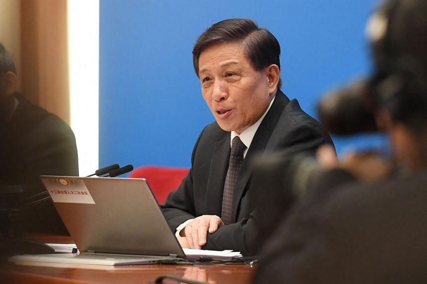 National People's Congress spokesman Zhang Yesui speaks at a press conference a day before the opening of the annual session of China's parliament, in Beijing's Great Hall of the People on March 4, 2019.