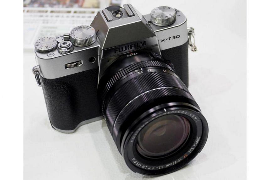 The X-T30 looks just like a smaller X-T3, Fujifilm's SLR-like flagship mirrorless camera.