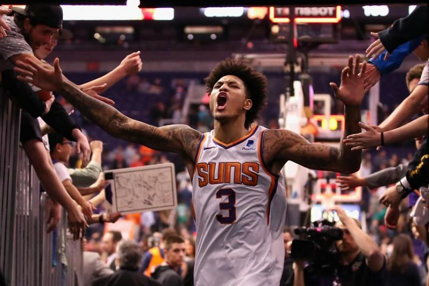 The Phoenix Suns' Kelly Oubre celebrates with fans after defeating the Milwaukee Bucks at Talking Stick Resort Arena in Phoenix, Arizona, on March 4, 2019.