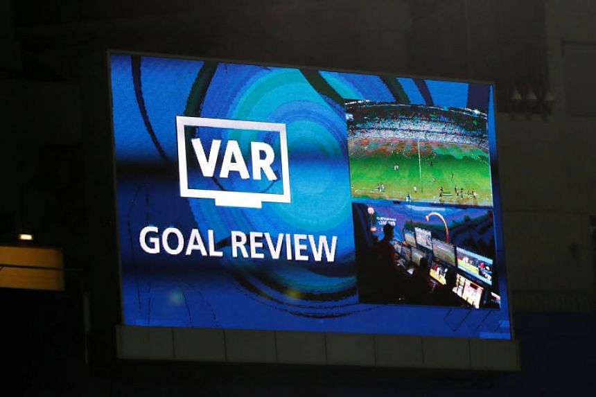 The big screen displays a message as a goal is reviewed by VAR at the Hazza bin Zayed Stadium, Al Ain, United Arab Emirates, on Dec 12, 2018.