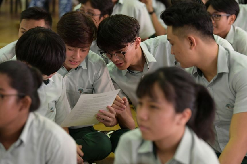 Students from Hillgrove Secondary School receiving their result slips. Streaming was introduced in Singapore from the 1980s to sort students into different tracks according to their abilities.