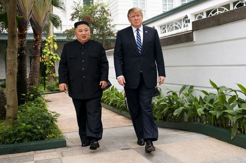 US President Donald Trump (right) and North Korean leader Kim Jong Un, walking together to a meeting at the Metropole Hotel in Hanoi, Vietnam, on Feb 28, 2019.