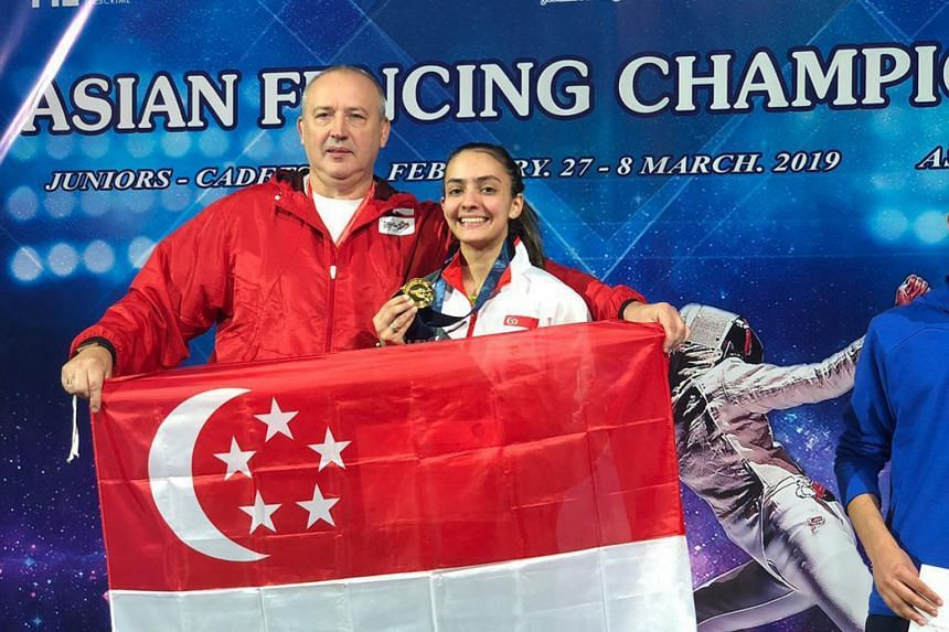 Amita Berthier posing with her gold medal with national coach Andrey Klyushin on Sunday after winning the junior (Under-20) final at the Asian Junior and Cadet Fencing Championships in Amman, Jordan. Below: Amita in action against Yang Chin-man of Ch